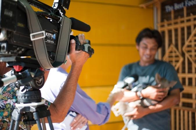 Dedy and Kai being filmed by KITV.
