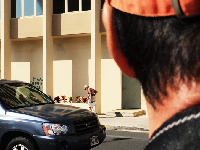 My father looks towards the Hawai`i Public Radio building, where I shared our story.