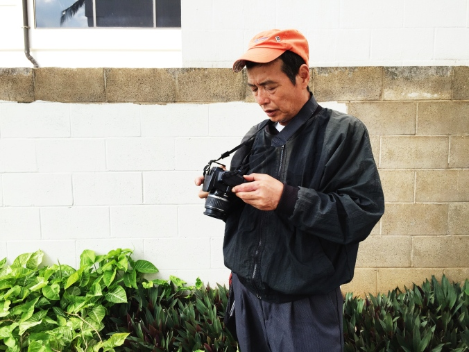 My father getting acquainted with his first digital camera.