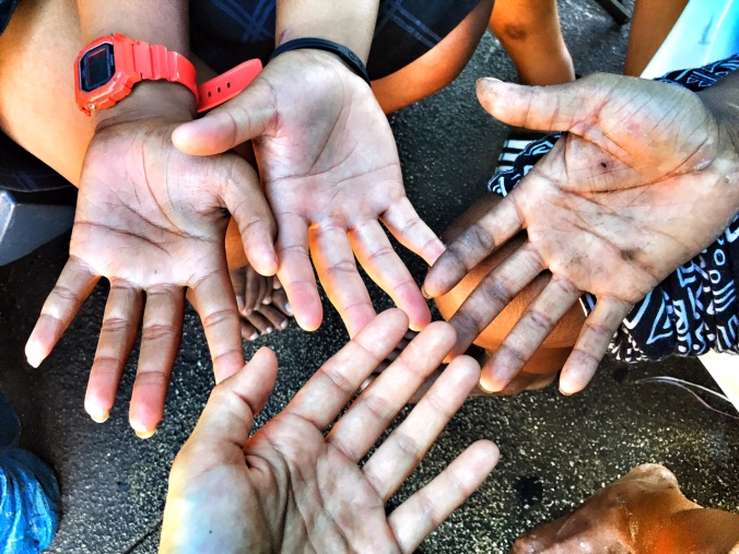 Hands of the youth in Kaka'ako.